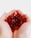 Cápsulas com medicina nas mãos Imagem de Stock