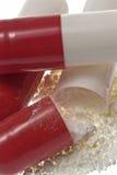 Cápsulas/comprimidos abertos Fotografia de Stock