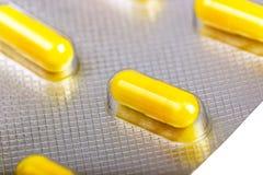 Cápsulas da medicina embaladas nas bolhas Imagens de Stock Royalty Free