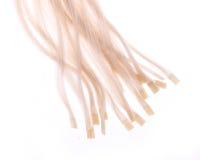 Cápsulas de la queratina de extensiones del pelo rubio Foto de archivo libre de regalías