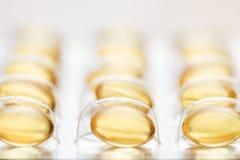 Cápsulas do óleo de peixes Fotografia de Stock