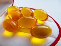 Cápsulas do óleo de peixes Omega-3 Fotos de Stock