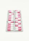 Cápsulas e comprimidos no pacote. Imagem de Stock