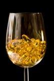 Cápsulas no vidro de vinho Foto de Stock