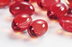 Cápsulas rojas Imagen de archivo