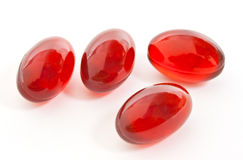 Cápsulas rojas del gel Imágenes de archivo libres de regalías