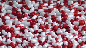 Cápsulas rojas y blancas de la salud almacen de video