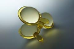 Cápsulas transparentes da vitamina do cabelo Fotografia de Stock Royalty Free