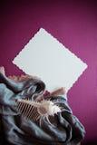 Cáscaras y papel con el draperie Fotos de archivo