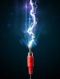 Câble électrique avec la foudre rougeoyante de l'électricité Photos libres de droits