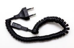 Câble électrique enroulé noir avec la prise Photos stock