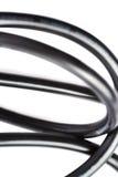 Câble électrique noir d'ordinateur d'isolement au-dessus du fond blanc Images libres de droits