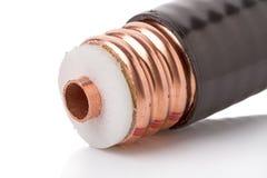 Câble coaxial de liaison épais sur le blanc Photo stock