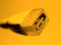 Câble d'USB dans l'orange image libre de droits