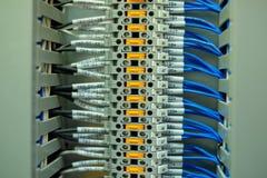 Câble de réseau dans le panneau de commande Photographie stock