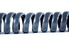 Câble téléphonique noir sur le fond blanc Images stock