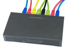 Câbles de réseau reliés au routeur Photographie stock libre de droits