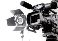 Câmara de vídeo e luz de Dv Fotografia de Stock