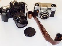A câmara digital verses a câmera do filme Fotografia de Stock