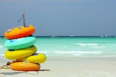Câmaras de ar da natação na praia Foto de Stock Royalty Free