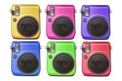 Câmaras digitais compactas de várias cores isoladas no fundo branco Fotos de Stock Royalty Free
