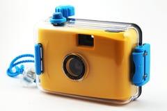 Câmera amarela na caixa impermeável Fotografia de Stock Royalty Free