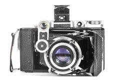 Câmera antiga com uma lente do acordeão imagem de stock