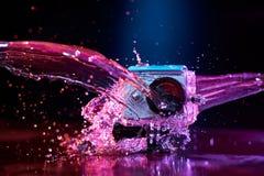 Câmera da ação espirrada com água Imagens de Stock Royalty Free