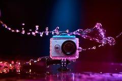 Câmera da ação espirrada com água Foto de Stock Royalty Free