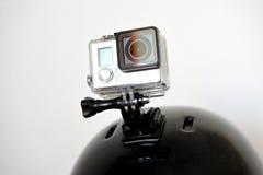 Câmera da ação no capacete dos esportes Fotos de Stock Royalty Free
