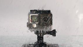Câmera da ação sob a chuva filme