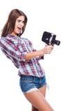 Câmera de filme como uma arma Fotografia de Stock
