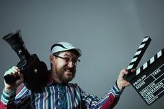 Câmera de filme e clapperboard retros masculinos gritando Imagem de Stock