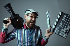 Câmera de filme e clapperboard retros masculinos gritando Imagens de Stock Royalty Free