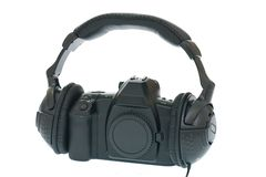 Câmera de SLR usando o auscultadores Fotografia de Stock