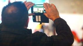 Câmera do musuc do concerto do telefone celular video estoque