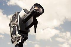 Câmera do vintage 8mm isolada no branco Fotos de Stock