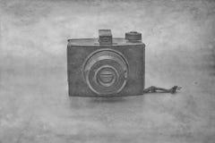 A câmera do vintage com filtro de papel aplicou-se à foto Fotos de Stock