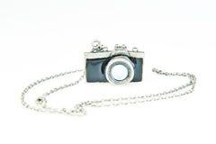 Câmera e colar Imagens de Stock