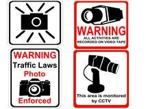 Câmera e sinais do CCTV Fotografia de Stock