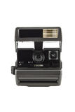 Câmera instantânea isolada em um fundo branco Fotografia de Stock Royalty Free