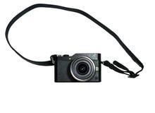 Câmera mirrorless preta com a lente no isolado branco Foto de Stock