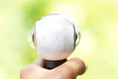 câmera panorâmico de 360 graus na mão humana Imagens de Stock Royalty Free