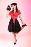 Câmera retro da mulher do estilo americano da menina Pin-acima Foto de Stock Royalty Free