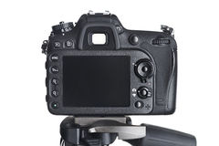 A câmera traseira de SLR da vista no tripé isolou o branco Fotografia de Stock Royalty Free