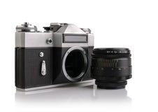 Câmera velha isolada em um branco Imagem de Stock
