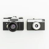 Câmeras retros velhas do filme Configuração lisa, vista superior Foto de Stock