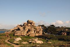 Pink Granite Coastal path near Perros Guirec in Brittany. Côte de Granit Rose is one of the most beautiful stretches of Brittany's coastline. The royalty free stock images