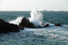 High waves at Pink Granite coast in Brittany. Côte de Granit Rose is one of the most beautiful stretches of Brittany's coastline. The unusual rock stock photography