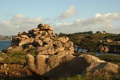 Pink Granite rocks near Perros Guirec in Brittany. Côte de Granit Rose is one of the most beautiful stretches of Brittany's coastline. The unusual rock stock photo